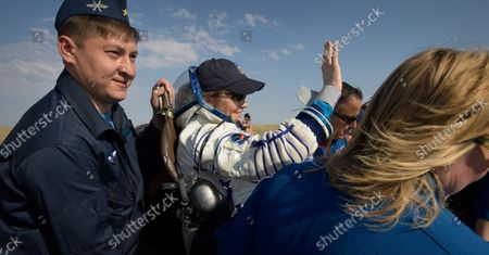 Expedition 59 astronaut Anne McClain of NASA is carried to a medical tent shortly after she, Canadian Space Agency astronaut David Saint-Jacques, and Roscosmos cosmonaut Oleg Kononenko landed in their Soyuz MS-11 spacecraft near the town of Zhezkazgan, Kazakhstan on June 25, 2019, Kazakh time (June 24 Eastern time). McClain, Saint-Jacques, and Kononenko are returning after 204 days in space where they served as members of the Expedition 58 and 59 crews onboard the International Space Station. NASA