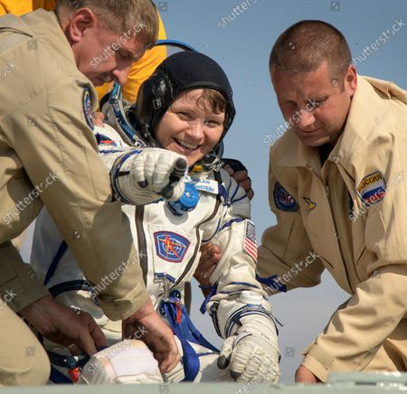 Expedition 59 NASA astronaut Anne McClain is helped out of the Soyuz MS-11 spacecraft just minutes after she, Canadian Space Agency astronaut David Saint-Jacques, and Roscosmos cosmonaut Oleg Kononenko, landed in a remote area near the town of Zhezkazgan, Kazakhstan on June 25, 2019, Kazakh time (June 24 Eastern time). McClain, Saint-Jacques, and Kononenko are returning after 204 days in space where they served as members of the Expedition 58 and 59 crews onboard the International Space Station. NASA