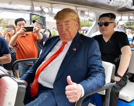 Howard X, impersonating North Korean leader Kim Jong Un and Dennis Alan(L), impersonator of U.S. President Donald Trump are seen at Osaka Castle in Osaka, Japan on June 26, 2019.