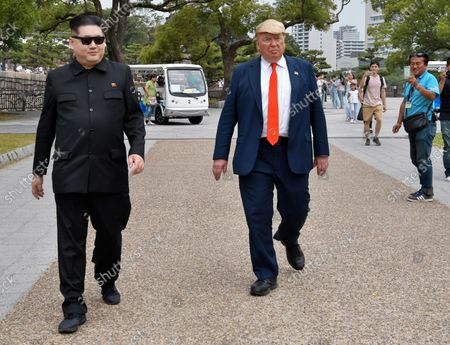 Howard X, impersonating North Korean leader Kim Jong Un and Dennis Alan(R), impersonator of U.S. President Donald Trump are seen at Osaka Castle in Osaka, Japan on June 26, 2019.