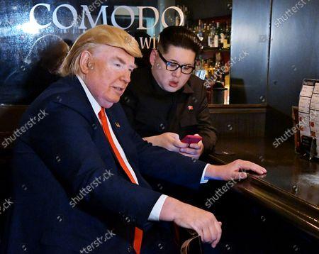 (R-L) Howard X, impersonating North Korean leader Kim Jong Un, Dennis Alan, impersonator of U.S. President Donald Trump wait for them stage at Jazz Bar in Osaka, Japan on Thursday, June 27, 2019.