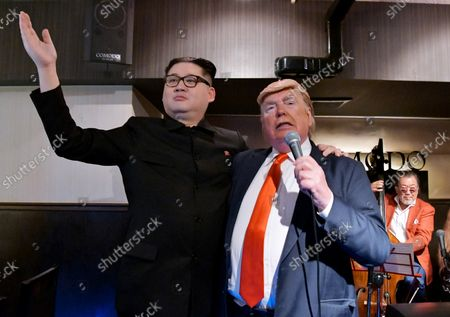 Howard X, impersonating North Korean leader Kim Jong Un and Dennis Alan (R), impersonator of U.S. President Donald Trump pose for photographers at Jazz Bar in Osaka, Japan on Thursday, June 27, 2019.