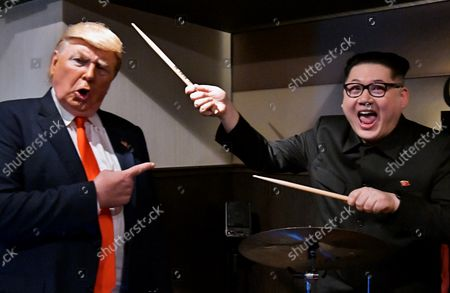 Howard X, impersonating North Korean leader Kim Jong Un and Dennis Alan (L), impersonator of U.S. President Donald Trump pose for photographers at Jazz Bar in Osaka, Japan on Thursday, June 27, 2019.