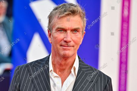 Philippe Caroit poses as she arrives on the red carpet during the 47th Deauville US Film Festival in Deauville, western France, on September 4, 2021