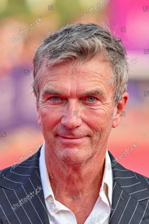 Stock Photo of Philippe Caroit poses as she arrives on the red carpet during the 47th Deauville US Film Festival in Deauville, western France, on September 4, 2021