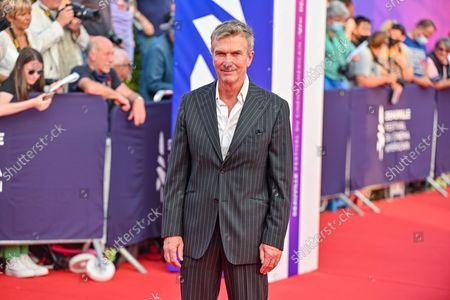 Stock Picture of Philippe Caroit poses as she arrives on the red carpet during the 47th Deauville US Film Festival in Deauville, western France, on September 4, 2021
