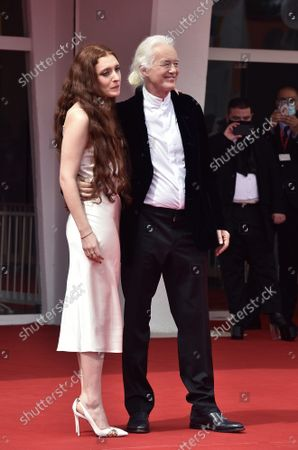 """Scarlett Sabet and Jimmy Page attend the red carpet of the movie """"Becoming Led Zeppelin"""" during the 78th Venice International Film Festival on Monday, September 0, 2021 in Venice, Italy."""