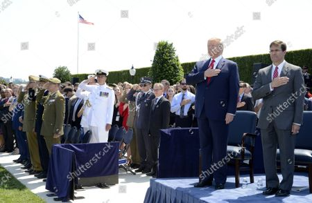 President Donald Trump (L) attends the welcome ceremony for the new Secretary of Defense Mark Esper, at the Pentagon, Thursday, July 25, 2019, Washington, DC. The Department of Defense has been without a full-time leader since former Secretary Jim Mattis resigned in December 2018.