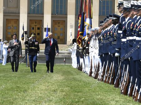 President Donald Trump (R) salutes as he reviews troops with the new Secretary of Defense Mark Esper (L) and Vice Chairman of the Joint Chiefs of Staff Gen. Paul Selva, at the Pentagon, Thursday, July 25, 2019, Washington, DC. The Department of Defense has been without a full-time leader since former Secretary Jim Mattis resigned in December 2018.