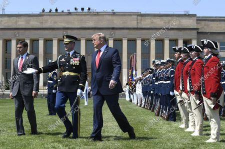 President Donald Trump (L) concludes a review of troops with the new Secretary of Defense Mark Esper (R) and Vice Chairman of the Joint Chiefs of Staff Gen. Paul Selva, at the Pentagon, Thursday, July 25, 2019, Washington, DC. The Department of Defense has been without a full-time leader since former Secretary Jim Mattis resigned in December 2018.