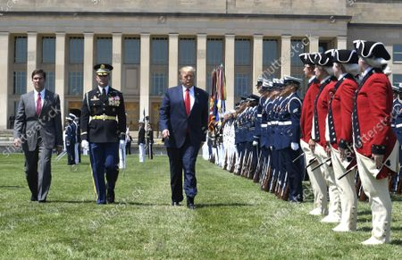 President Donald Trump (R) reviews troops with the new Secretary of Defense Mark Esper (L) and Vice Chairman of the Joint Chiefs of Staff Gen. Paul Selva, at the Pentagon, Thursday, July 25, 2019, Washington, DC. The Department of Defense has been without a full-time leader since former Secretary Jim Mattis resigned in December 2018.