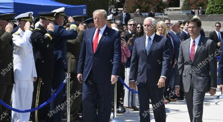 President Donald Trump (L) walks past an honor guard with the new Secretary of Defense Mark Esper (R) and Vice President Mike Pence (C), at the Pentagon, Thursday, July 25, 2019, Washington, DC. The Department of Defense has been without a full-time leader since former Secretary Jim Mattis resigned in December 2018.