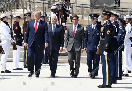 President Donald Trump (L) walks past an honor guard with the new Secretary of Defense Mark Esper (2nd,R), Vice President Mike Pence (2nd,L) and Vice Chairman of the Joint Chiefs of Staff Gen. Paul Selva (L), at the Pentagon, Thursday, July 25, 2019, Washington, DC. The Department of Defense has been without a full-time leader since former Secretary Jim Mattis resigned in December 2018.