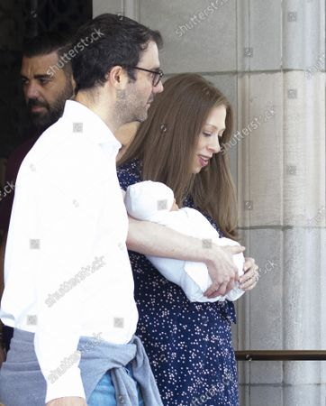 Stock Picture of Marc Mezvinsky walks with  Chelsea Clinton who holds her newborn baby son Jasper as they exit Lenox Hill Hospital in New York City on Thursday, July 25, 2019. Jasper joins big siblings Charlotte, 4, and Aidan, 3 to the family.