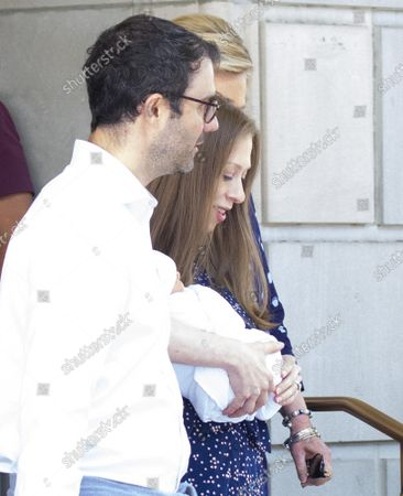 Marc Mezvinsky walks with Chelsea Clinton who holds her newborn baby son Jasper as they exit Lenox Hill Hospital in New York City on Thursday, July 25, 2019. Jasper joins big siblings Charlotte, 4, and Aidan, 3 to the family.