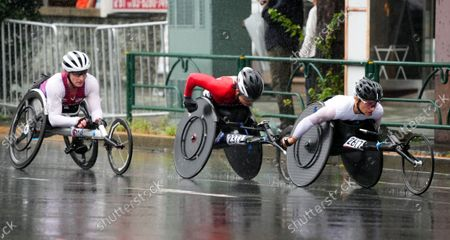 Stock Image of (L-R) Tatyana McFadden (USA), Wakako Tsuchida (JPN), Manuela Schar (SUI) - Marathon : Women's Marathon T54 during the Tokyo 2020 Paralympic Games in Tokyo, Japan.