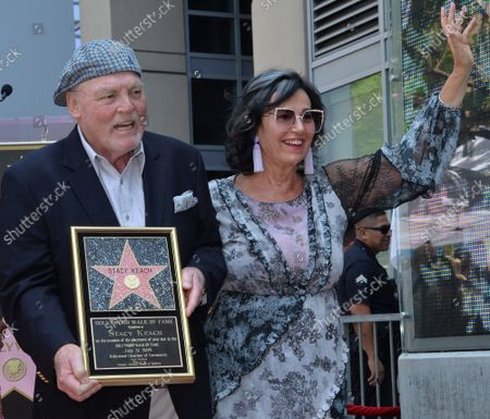Actor Stacy Keach (L) is joined by his wife, former Polish model and actress Malgosia Tomassi during a ceremony honoring him with the 2,668th star on the Hollywood Walk of Fame in Los Angeles on Wednesday, July 31, 2019.