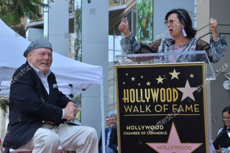 Actor Stacy Keach (L) reacts to comments by his wife, former Polish model and actress Malgosia Tomassi during a ceremony honoring him with the 2,668th star on the Hollywood Walk of Fame in Los Angeles on Wednesday, July 31, 2019.