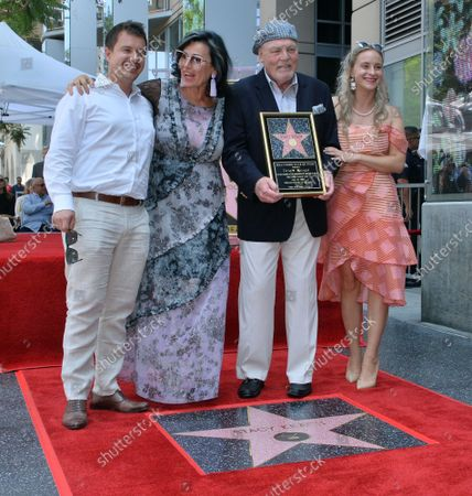 Actor Stacy Keach (3rd-L) is joined by his wife, former Polish model and actress Malgosia Tomassi (2nd-L) and their son Shannon Keach (L) and daughter Karolina Keach (R) during a ceremony honoring him with the 2,668th star on the Hollywood Walk of Fame in Los Angeles on Wednesday, July 31, 2019.