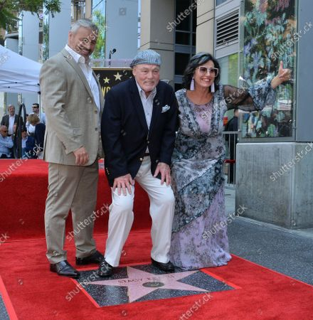 Stock Picture of Actor Stacy Keach (C) is joined by actor Matt LeBlanc (L) and his wife, former Polish model and actress Malgosia Tomassi during a ceremony honoring him with the 2,668th star on the Hollywood Walk of Fame in Los Angeles on Wednesday, July 31, 2019.
