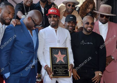 Recording artist and music producer Teddy Riley (C) holds a replica plaque as he is joined by record executive Andre Harrell (L) and rapper Jermaine Dupri (R) during an unveiling ceremony honoring him with the 2,670th star on the Hollywood Walk of Fame in Los Angeles on Friday, August 16, 2019.