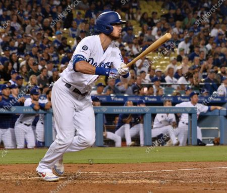Los Angeles Dodgers' Cody Bellinger doubles to right in the ninth inning against the Toronto Blue Jays at Dodger Stadium in Los Angeles on Thursday, August 22, 2019. Corey Seagar doubled, driving in Max Muncy and Bellinger to tie the score. Kike Hernandez then hit a walkout single to win the game 3-2. It is the Dodgers 12th walk-off victory this season.