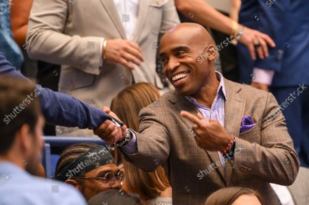 Former NFL player Tiki Barber shakes hands during Opening Ceremonies in Arthur Ashe Stadium at the 2019 US Open Tennis Championships at the USTA Billie Jean King National Tennis Center on Monday, August 26, 2019 in New York City.