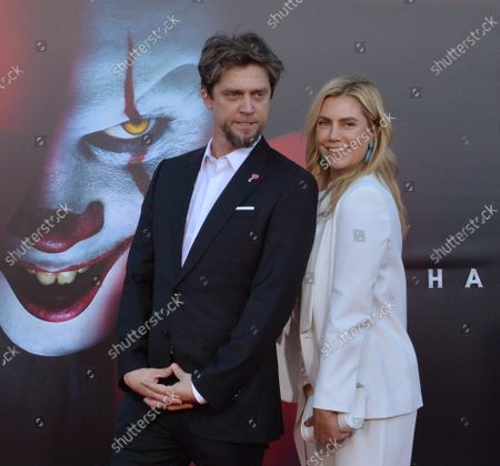 """Director Andy Muschietti  and a guest attend the premiere of the motion picture horror film """"It Chapter Two"""" at the Regency Village Theatre in the Westwood section of Los Angeles on Tuesday, August 26, 2019. Storyline: Twenty-seven years after their first encounter with the terrifying Pennywise, the Losers Club have grown up and moved away, until a devastating phone call brings them back."""