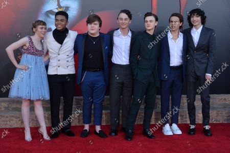 """Cast members Sophia Lillis, Chosen Jacobs, Jeremy Ray Taylor, Wyatt Oleff, Jaeden Martell, Jack Dylan Grazer and Finn Wolfhard (L-R) gather for a photo-op during the premiere of the motion picture horror film """"It Chapter Two"""" at the Regency Village Theatre in the Westwood section of Los Angeles on Tuesday, August 26, 2019. Storyline: Twenty-seven years after their first encounter with the terrifying Pennywise, the Losers Club have grown up and moved away, until a devastating phone call brings them back."""