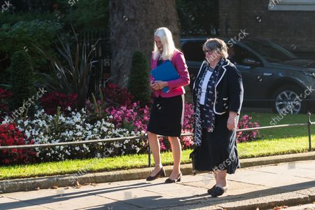 Stock Photo of LONDON, UNITED KINGDOM - SEPTEMBER 07, 2021: Conservative Party Chairman and Minister without Portfolio Amanda Milling (L) and Secretary of State for Work and Pensions Therese Coffey (R) arrive in Downing Street in central London to attend the first in-person Cabinet meeting this year following the return of Parliament after summer recess on September 07, 2021 in London, England.