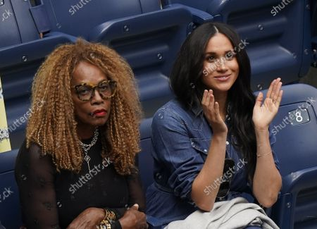 Stock Photo of Meghan, Duchess of Sussex, sits with Oracene Price (L), Serena Williams' mother, as they watch Serena Williams, of the United States, play Bianca Andreescu, of Canada, in the Woman's Championship at the 2019 US Open Tennis Championships at the USTA Billie Jean King National Tennis Center on Saturday, September 7, 2019 in New York City.