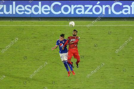 Daniel Ruiz de Millonarios and Jorge Posada de Patriotas dispute the ball during a match between Millonarios and Patriotas during the BetPlay League DIMAYOR at The Estadio Nemesio Camacho El Campin, in Bogota', Colombia, on September 7, 2021.