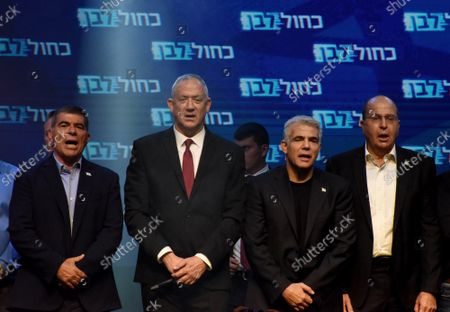 Stock Image of Leaders of the Blue and White Party, (L_R) Gabi Ashkenazi, Benny Gantz, Yair Lapid, Benny Gantz and Moshe Ya'alon sing the Israeli national anthem, HaTikva, in Tel Aviv, Israel, after election polls predicted his party is leading in the Israeli national elections, Wednesday, September 18, 2019. According to exit polls, Gantz's party will be the largest party in the Israeli Knesset, while Prime Minister Benjamin Netanyahu's Likud party lost seats.