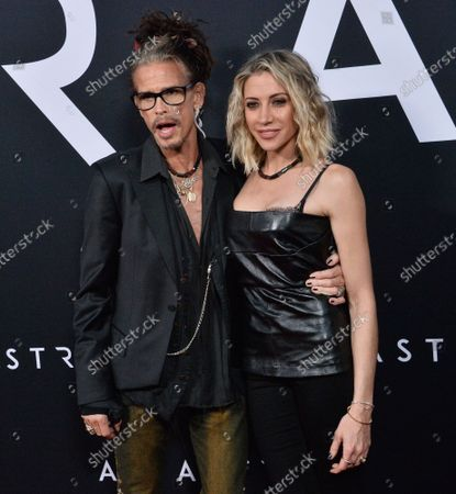 """Aerosmith lead singer Steven Tyler and his girlfriend Aimee Preston attend the premiere of the motion picture sci-fi thriller """"Ad Astra"""" at the ArcLight Cinerama Dome in the Hollywood section of Los Angeles on Wednesday, September 18, 2019. Storyline: Astronaut Roy McBride (Brad Pitt) travels to the outer edges of the solar system to find his missing father and unravel a mystery that threatens the survival of our planet. His journey will uncover secrets that challenge the nature of human existence and our place in the cosmos."""