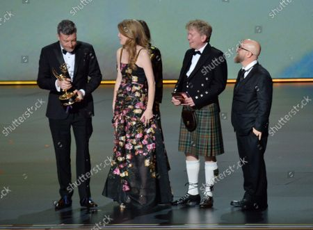 (L-R) Charlie Brooker, Annabel Jones, Konnie Huq, Russell McLean and David Slade accept the Outstanding Television Movie award for 'Bandersnatch (Black Mirror)' onstage during the 71st annual Primetime Emmy Awards at the Microsoft Theater in downtown Los Angeles on Sunday, September 22, 2019.