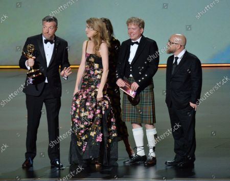 Stock Picture of (L-R) Charlie Brooker, Annabel Jones, Konnie Huq, Russell McLean and David Slade accept the Outstanding Television Movie award for 'Bandersnatch (Black Mirror)' onstage during the 71st annual Primetime Emmy Awards at the Microsoft Theater in downtown Los Angeles on Sunday, September 22, 2019.