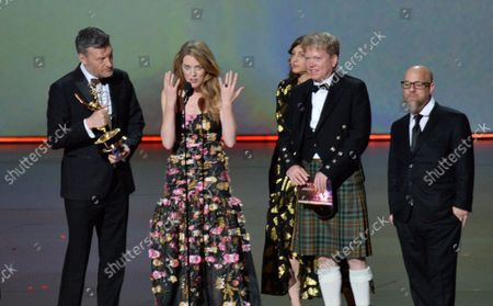 Stock Photo of (L-R) Charlie Brooker, Annabel Jones, Konnie Huq, Russell McLean and David Slade accept the Outstanding Television Movie award for 'Bandersnatch (Black Mirror)' onstage during the 71st annual Primetime Emmy Awards at the Microsoft Theater in downtown Los Angeles on Sunday, September 22, 2019.