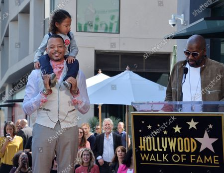 Actor Terrence Howard reacts to comments by director Malcolm D. Lee with his son Hero Howard on his shoulders during an unveiling ceremony honoring him with the 2,674th star on the Hollywood Walk of Fame in Los Angeles on Tuesday, September 24, 2019.