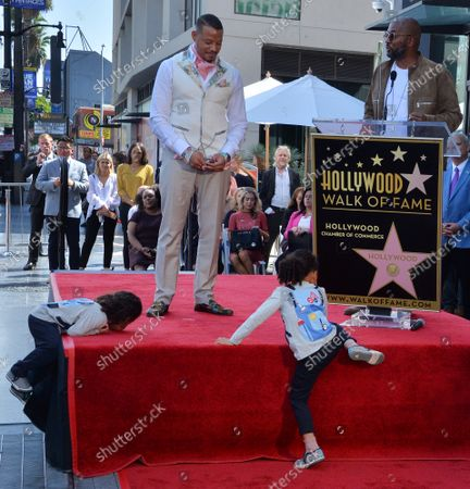 Hero Howard and Qirin Howard climb on the platform during an unveiling ceremony honoring their father, actor Terrence Howard (rear) with the 2,674th star on the Hollywood Walk of Fame in Los Angeles on Tuesday, September 24, 2019.