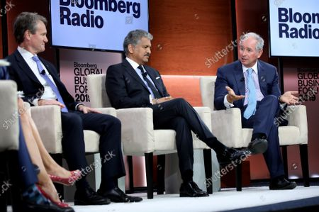 Stephen Schwarzman (R), CEO of the Blackstone Group, speaks as Brian Moynihan, center, CEO of Bank of America, and Anand Mahindra, chairman of Mahindra Group, listen during a live TV broadcast during the third annual Bloomberg Global Business Forum held at the Plaza Hotel in New York City on Wednesday, September 25, 2019. Political and business leaders attending the forum are discussing how climate changes effects the world's economy and possible solutions to the crisis.