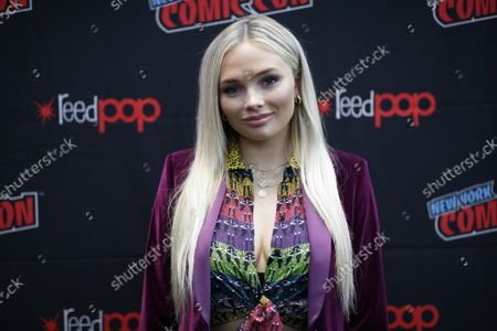 Natalie Alyn Lind of the series Tell Me a Story arrives for photos at New York Comic Con at the Jacob K. Javits Center on Thursday,  October 3, 2019 in New York City. The New York Comic Con is an annual New York City fan convention dedicated to comics, graphic novels, anime, manga, video games, toys, movies, and television. It was first held in 2006.