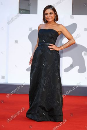 Antonia Truppo poses for photographers upon arrival at the premiere of the film 'The King of Laughter' during the 78th edition of the Venice Film Festival in Venice, Italy