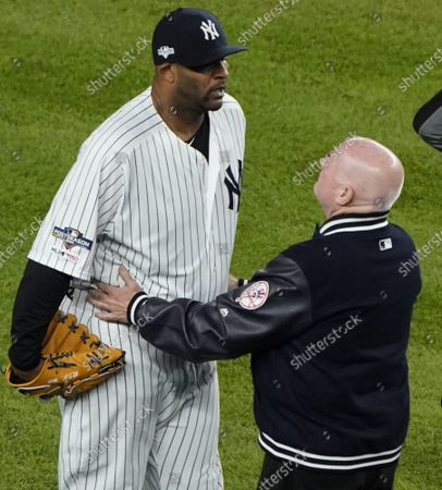 New York Yankees pitcher CC Sabathia is examined by a team doctor in the eighth inning of Game 4 of the American League Championship Series against the Houston Astros in the 2019 MLB Playoffs at Yankee Stadium in New York City on Thursday, October 17, 2019.