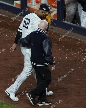 New York Yankees pitcher CC Sabathia covers his face as he walks off the field with an injury in the eighth inning of Game 4 of the American League Championship Series against the Houston Astros in the 2019 MLB Playoffs at Yankee Stadium in New York City on Thursday, October 17, 2019.
