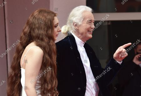"""Scarlett Sabet and Jimmy Page attend the red carpet of the movie """"Becoming Led Zeppelin"""" during the 78th Venice International Film Festival on Monday, September 6, 2021 in Venice, Italy."""