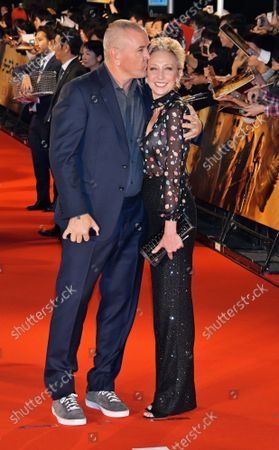 """Director Tim Miller(L) and his wife Jennifer Miller pose for photographers during the Japan premiere for the film """"Terminator: Dark Fate"""" in Tokyo, Japan on Wednesday, November 6, 2019. This film open November 8 in Japan."""