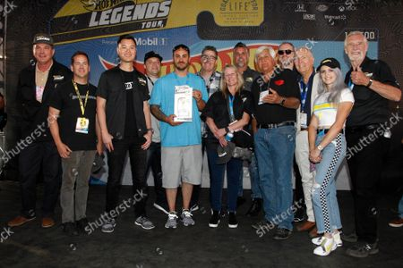 HotWheels award winner Dave Ford and Greg Salzillo (center) on stage with judges including David Addison, Adam Carolla, Richard Rawlings, Jay Leno, Maximillion Cooper, Peter Brock and Colette Davis during the 2019 SEMA Show, at the Las Vegas Convention center in Las Vegas, Nevada, on Tuesday, November 5, 2019.