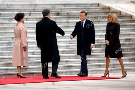 """French President Emmanuel Macron (2nd-R) and his wife Brigitte (R) are greeted by Chinese President Xi Jinping and his wife Peng Liyuan for a welcoming ceremony at the Great Hall of the People in Beijing on Wednesday, November 6, 2019.  After the ceremony, Xi said the two leaders had """"sent a strong signal to the world about steadfastly upholding multilateralism and free trade, as well as working together to build open economies."""""""