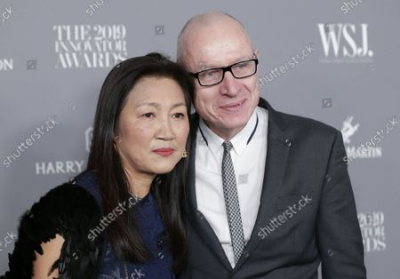 Stock Image of Wang Ping and Robert Thomson arrive on the red carpet at the WSJ Mag 2019 Innovator Awards at The Museum of Modern Art on Wednesday, November 06, 2019 in New York City.