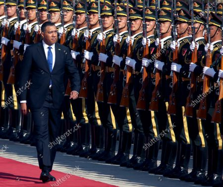 Jamaican Prime Minister Andrew Holness inspects a Chinese military honor guard during a welcoming ceremony at the Great Hall of the People in Beijing on Friday, November 68, 2019.  Holness welcomed the opportunity to work with China in areas such as renewable energy, border security, agriculture, health care and STEM education to bolster Jamaica's economy.